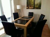Oak 6 seater table with 6 matching leather chairs