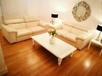 Natuzzi Cream Leather sofas