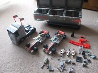Lego style Formula 1 McLaren race cars and lorry