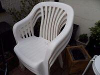 Six White Plastic Chairs & Three Steel Stools Plus Small Table