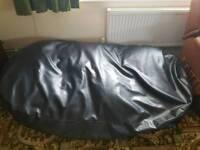 Large black beanbag for sitting