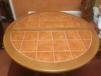 Round /oval dinning room table. + 2 wooden chairs