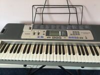 Casio Electric Keyboard with stand