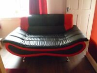 2x2 seater black/red leather sofa