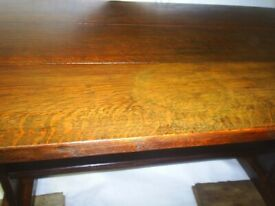 Solid oak old vintage refectory style coffee table full of character and charm.