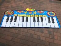 bauin step to play giant piano