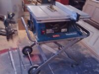 Makita folding table saw with wheeled stand