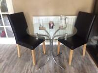 Two seat glass top dining table