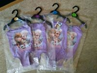 Girls frozen anna and elsa swimsuit. brand new with tags .age 1.5 to 5 years