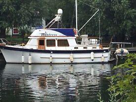 Trawler 11.98M twin engines good live aboard cheep moorings fibre glass hull teak inside must see.