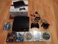 Boxed sony playstation 3 slim 120gb with official pad and 6 games very good condition