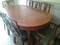 Rosewood oriental dining table,6 chairs and 2 carvers.
