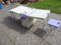 cooler box with folding table and two chairs