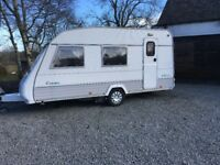 Touring caravan Sterling Europa 4 berth 1996 model , motor mover accessories and porch awning.
