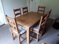 Six solid wood chairs with free table