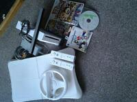 Nintendo Wii with 2 consoles, Wii wheel and Wii fit board