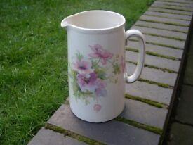 An vintage ceramic jug with attractive floral design.