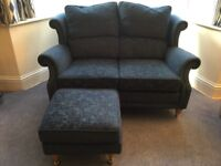 2 seater sofa with matching footstool.