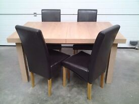 Ex display extendable dining table and 4 chairs. CHOC BROWN. Less 1/3 shop sale price. Can deliver.