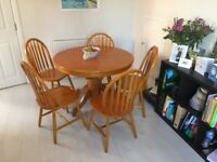 Pine extendable dining table with five matching chairs