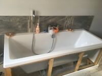 Bath with taps and fittings.
