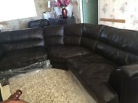 Genuine leather corner sofa with matching chair.