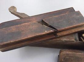 A set of three wooden bench planes