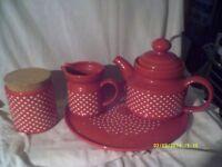TEAPOT a LARGE RED ONE , PLUS A COLLECTION of MATCHING CHINA , ALL ON A CHINA TRAY .