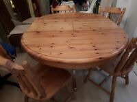 Pine extending table & 4 matching chairs