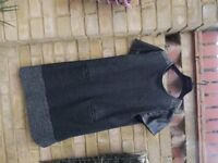 Size 16 short sleeved dress. Black with grey speckled borders. Leather like trims.