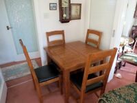 Medium oak kitchen / dining table & chairs