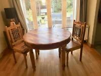 Solid wooden dining room table and chairs