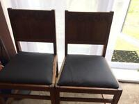 Two vintage chairs by ercol