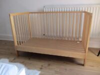 Cot bed with safety bar