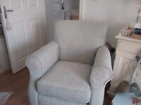 Armchair with large foot stool