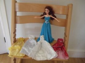 Barbie like doll and evening dresses