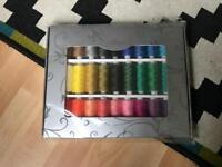 Rainbow coloured sewing machine thread pack.
