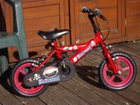 LITTLE BOYS RED BIKE WOULD SUIT A 3 TO 5 YEAR OLD .