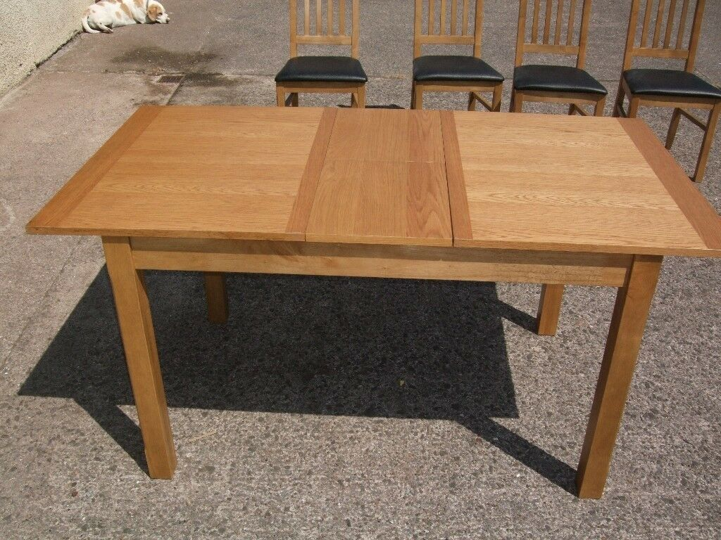 Extendable wooden table with 4 matching chairs. | in ...
