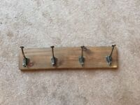 Used wooden coat rack with wrought iron hooks