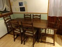 """Dark hardwood dining table and 6 chairs (4 chairs and 2 carver chairs) 63"""" x 30"""""""