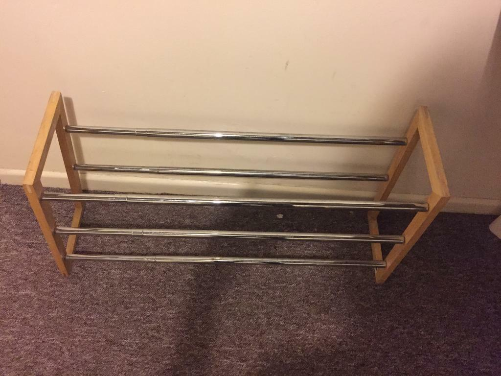 Cheap Shoe Stand (Extends Very Widein Penryn, CornwallGumtree - This shoe stand extends wide. Metal and wood. Can hold a lot of shoes. Moving but I cant take it with me. Serious enquiries only!!!!!!!!, delivery can be negotiated. Message to inquire!!