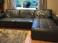 BARGAIN - Black leather corner sofa with pullout double bed and storage .