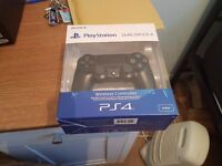 New Sony PlayStation DualShock 4 version 2 still sealed and boxed