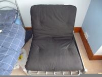 Single futon chair/bed. Silver Frame with black futon