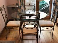 Metal glass topped table and chairs