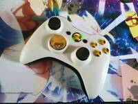 Xbox 360 wireless controllers in white