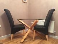 Round glass table oak legs 2 mat black chairs
