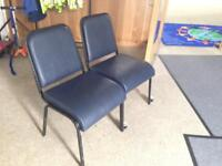 120 Dark blue faux leather stackable stacking chairs.