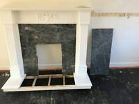 White fireplace with marble effect centre and heart
